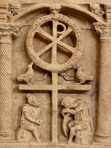 The Chi Rho with a wreath symbolizing the victory of the Resurrection, above Roman soldiers, c. 350